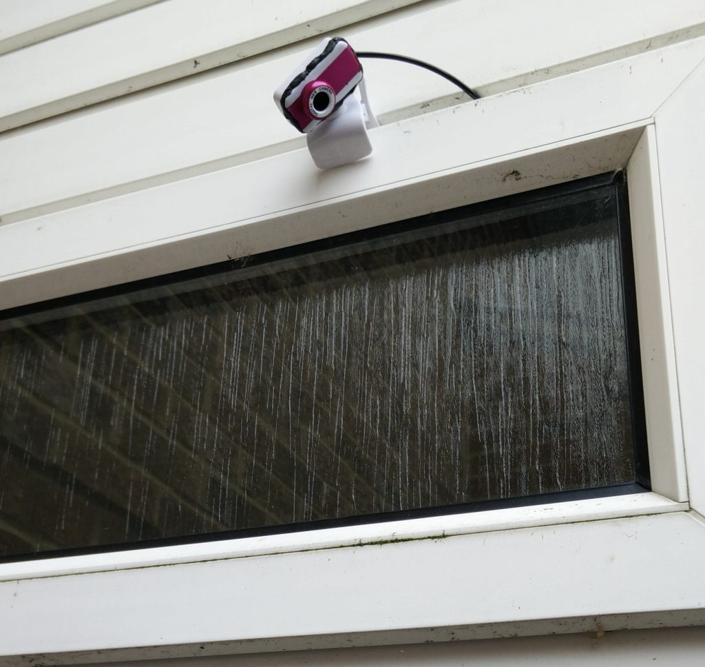 USB webcam mounted outside window